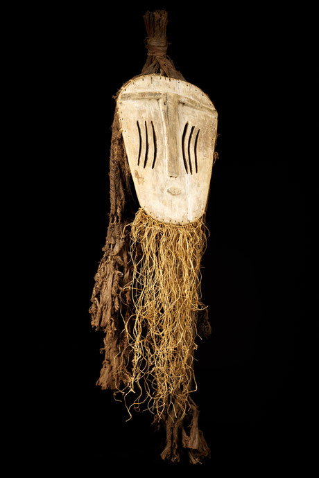 Very distinctive masks, unmistakably due to the deep scarification on the cheeks.
