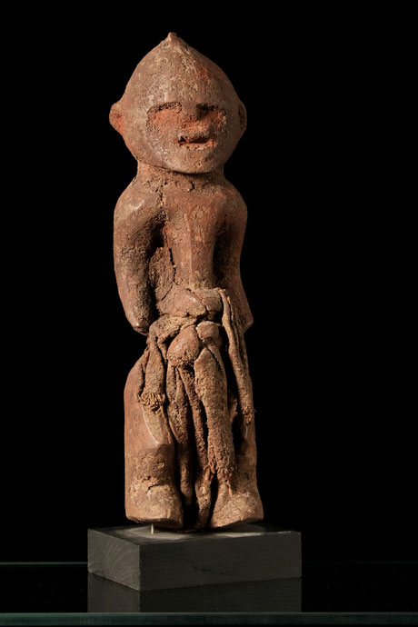 Boki figure with red crusty patina and scarf around the waist