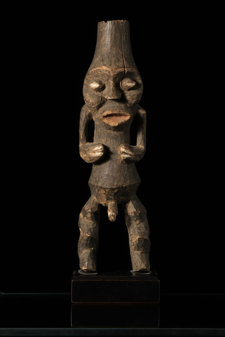 Mambila figure with hollow head and body, dry patina.