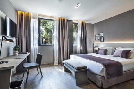 Найти отель в спокойном районе Барселоны
