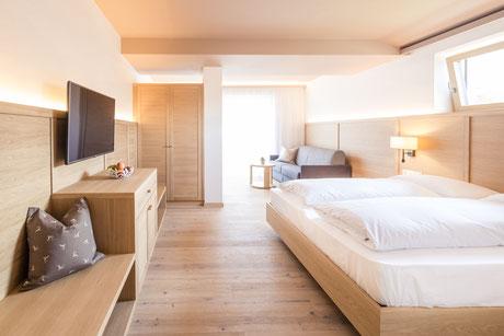 Wohnzimmer Alpin Chalet - Garni Hotel Clara