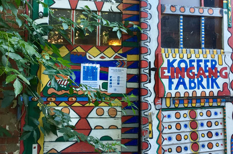 Conference participants playing pinball during casual reception of LANE 2016