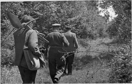Major Pedder goes to inspect an isolated grave with two assistants