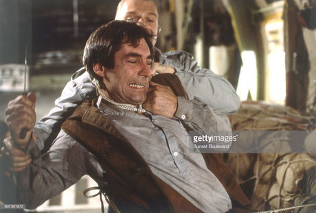 ©Corbis via Getty Images // Andreas und Timothy Dalton in The Living Daylights