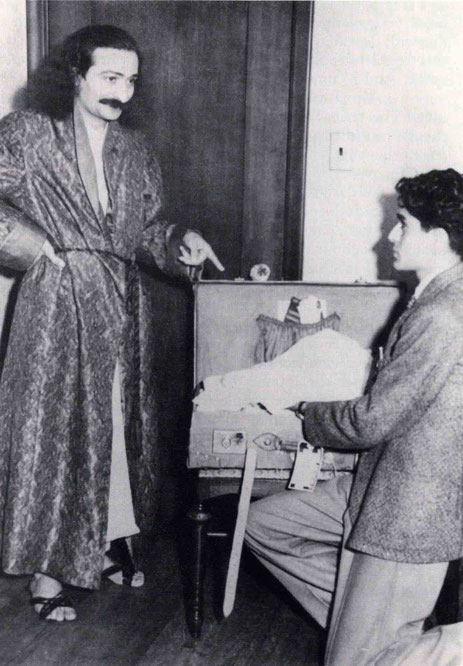 Meher Baba and his youngest brother Adi Jr(n). unpacking Baba's suitcase.