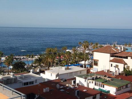 Bild mit Ansicht der Wohnung auf das Meer und Link zur weiteren Beschreibung der Immobilie.