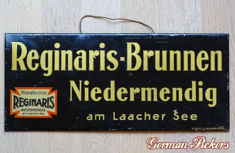 Reginaris - u. Genoveva - Brunnen Erstklassige Tafelwässer Niedermendig / Laacher See - Blechschild  Deutschland um 1930  15 x 35 cm, Hersteller Geissler & Co Vallendar