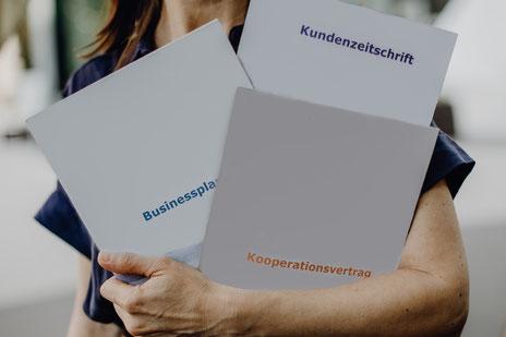 Profi-Übersetzungen ins Französische von Kundenzeitschrift, Kooperationsvertrag und Businessplan.