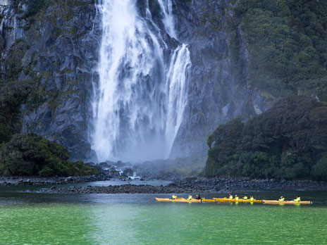 Kayakers in front of Bowen Falls in Milford Sound