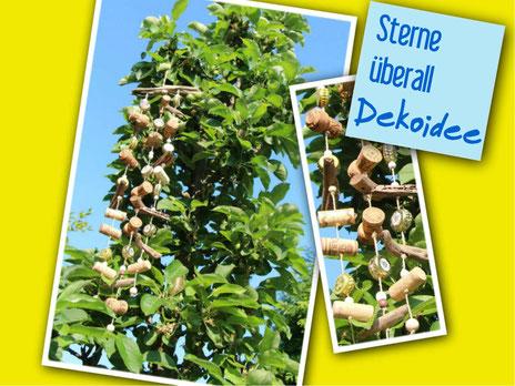 Upcyclingidee: Windspiel mit Korken im Apfelbaum schützt die heranwachsenden Äpfel