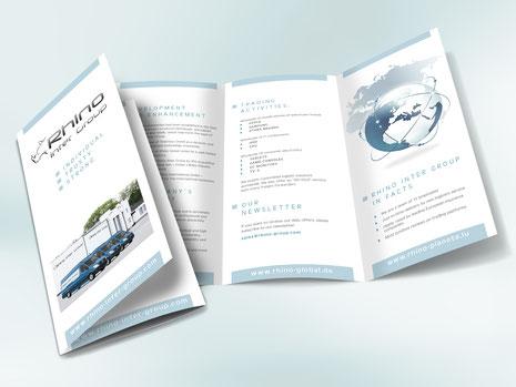 klappfolder-grafikwerkstatt-thielen-erde-transporter-weltkugel-nashorn-firma