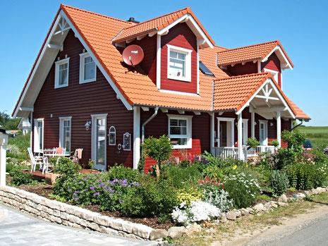 Öko- Haus ausgerichtet nach dem Rad des Lebens