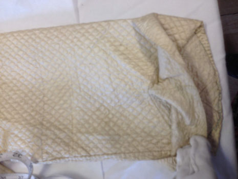 C18th quilted bedgown, showing cuff construction. BATMC 97.18 (loan)