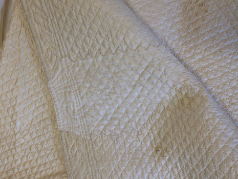 C18th quilted bedgown, showing mending. BATMC 97.18 (loan)