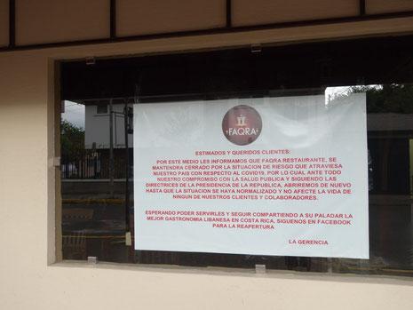 Poster on window of the restaurant Faqra, barrio Escalante, April 15, 2020.