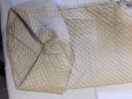 C18th quilted bedgown, showing inner elbow view of cuff. BATMC 97.18 (loan)