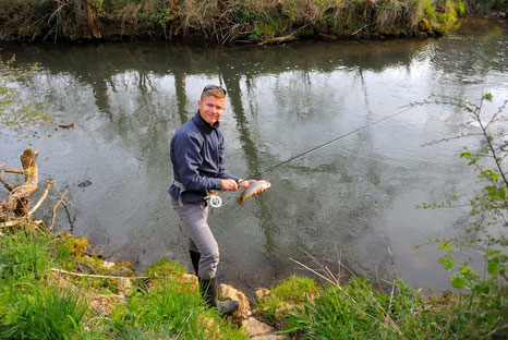 The Danica Dudes member Church catching a brown trout with a flyrod in the Lauterach