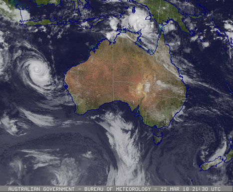 Colourised satellite image of Tropical Cyclone Nora and Severe Tropical Cyclone Marcus, 23/03/2018. Image from www.bom.gov.au.