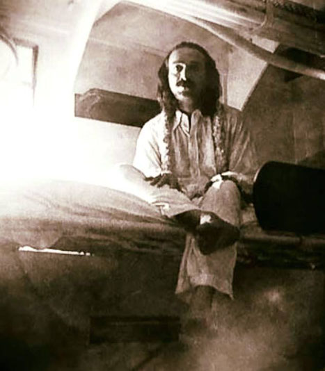 The picture of Meher Baba in his cabin, ship and date unknown.