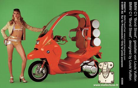 vente au enchère unicef scooter Louis Vuitton et BMW