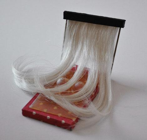 1ère tentative avec des cheveux artificiels et du latex transparent