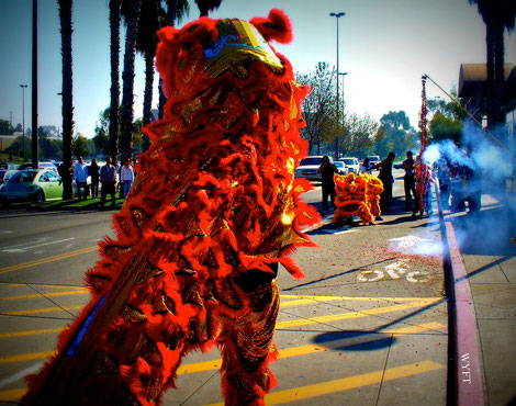 © Winifred. Lion dance, firecrackers and the auspicious color red are part of Lunar New Year celebration. The noisier, the merrier, the better! The Great Mall, Milpitas, CA.