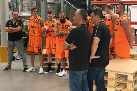 Positioning for the Panthers-team photos in the LMS warehouse.