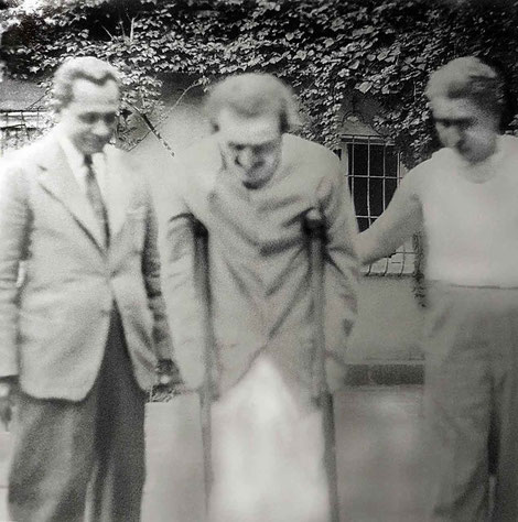 ( L - R ) Meherjee Karkaria, Meher Baba on crutches and Adi K. Irani at this time. Courtesy of LM page 3871 ( 1st ed. )