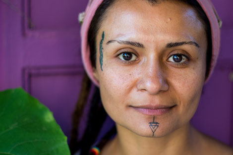 Sirma with her two facial tattoos
