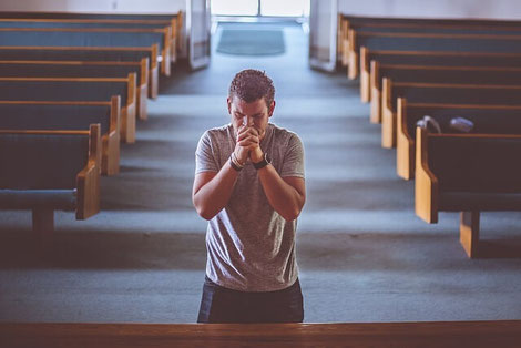 Nervous man praying