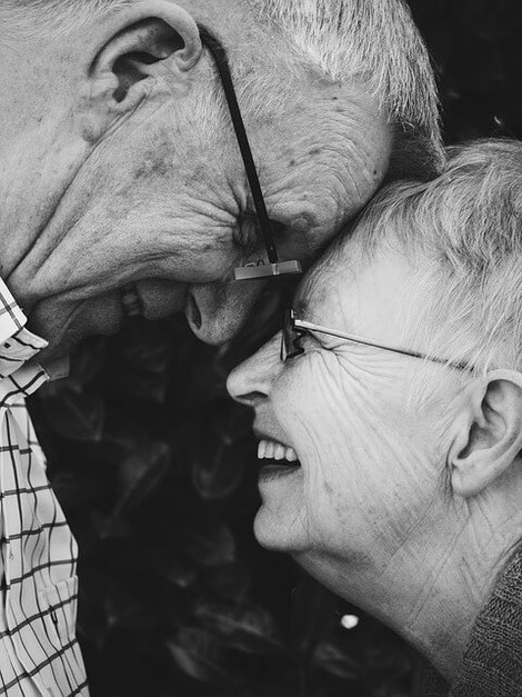 Old couple laughing.