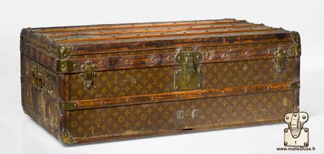 record prix malle cabine Louis Vuitton en salle des vente vintage mauvais etat