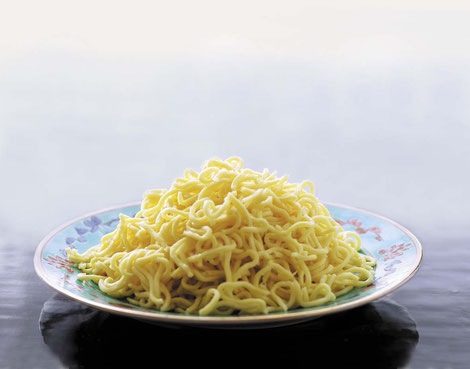 yellow mee on a plate