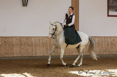 "Vera Munderloh and Lusitano stallion ""Super"" in a side saddle"