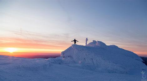 "Fabian standing on the top of the frozen ""Fischerhütte"" at 2053m"
