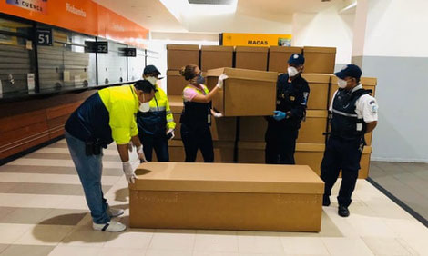 Cardboard coffins in Guayaquil. Photograph: Alcaldia Guyaquil/EPA