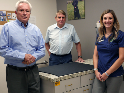 Dr. Darrell Fisher, Dr. Mike Korenko and Dr. Michelle Meyer in the animal clinic where the first treatment of IsoPet took place. (photo: Emily McCarty)