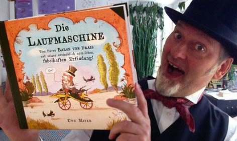 Uwe Mayer Autor und Illustrator Die Laufmaschine mit seinem Bilderbuch