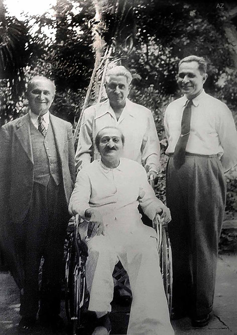 ( L - R ) standing ; Gustadji Hansotia, Adi K. Irani and Meherjee Karkaria with Meher Baba in the wheelchair at this time. Courtesy of LM page 3866 ( 1st ed. )
