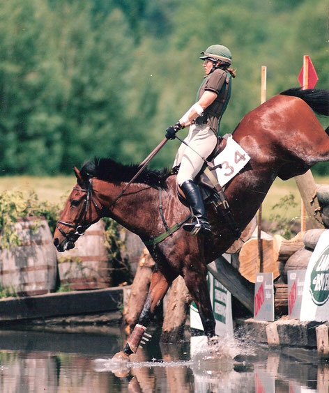 Event horse jumping into water