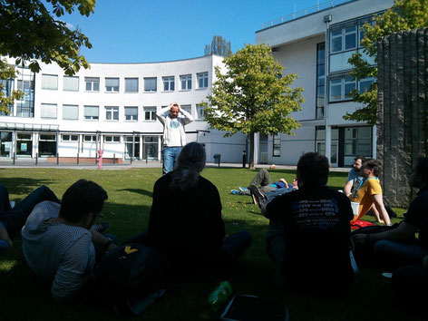 Johannes presenting outside in the sun