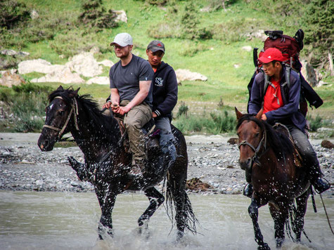 Crossing Jeti-Oguz river with a horse.