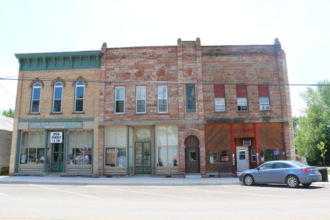 A photo of three historic buildings in Lyons, Michigan.