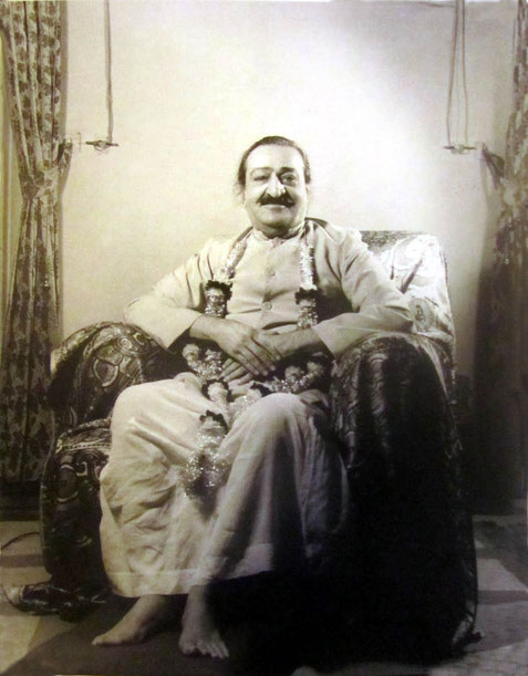 Baba seated with garland, Poona, 1959