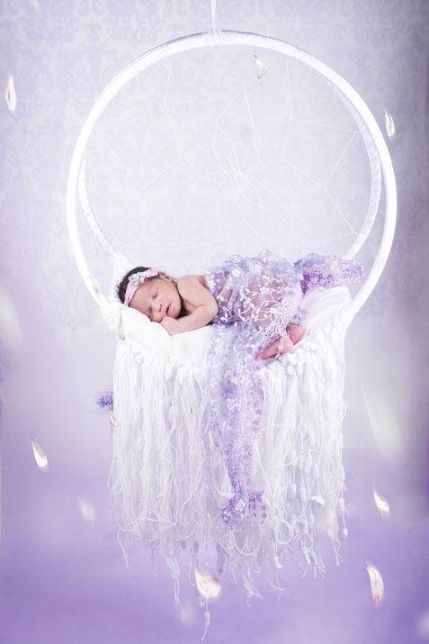 newborn lying in beautiful prop