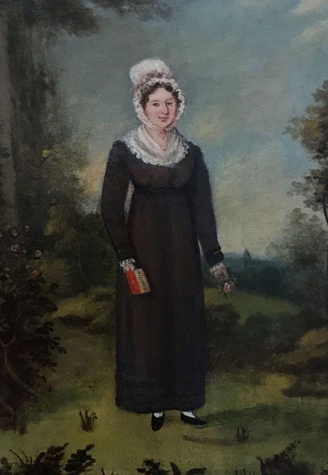Early 19th century oil  portrait of a girl with a book and flower
