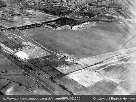 Castle Bromwich Aerodrome in the 1920s. The railway is bottom left; Castle Bromwich village is off the photograph to the left; the Chester Road runs left-to-right near the top; the buildings by the railway are the British Industries Fair.