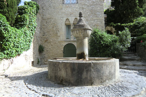 a picturesque small square and its fountain