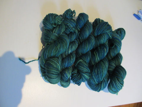 Green skeins of twisted up yarn