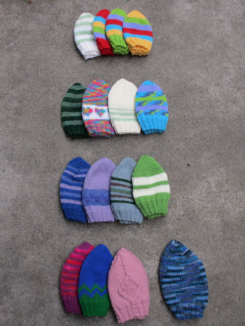 Sixteen stripy hats in various sizes.